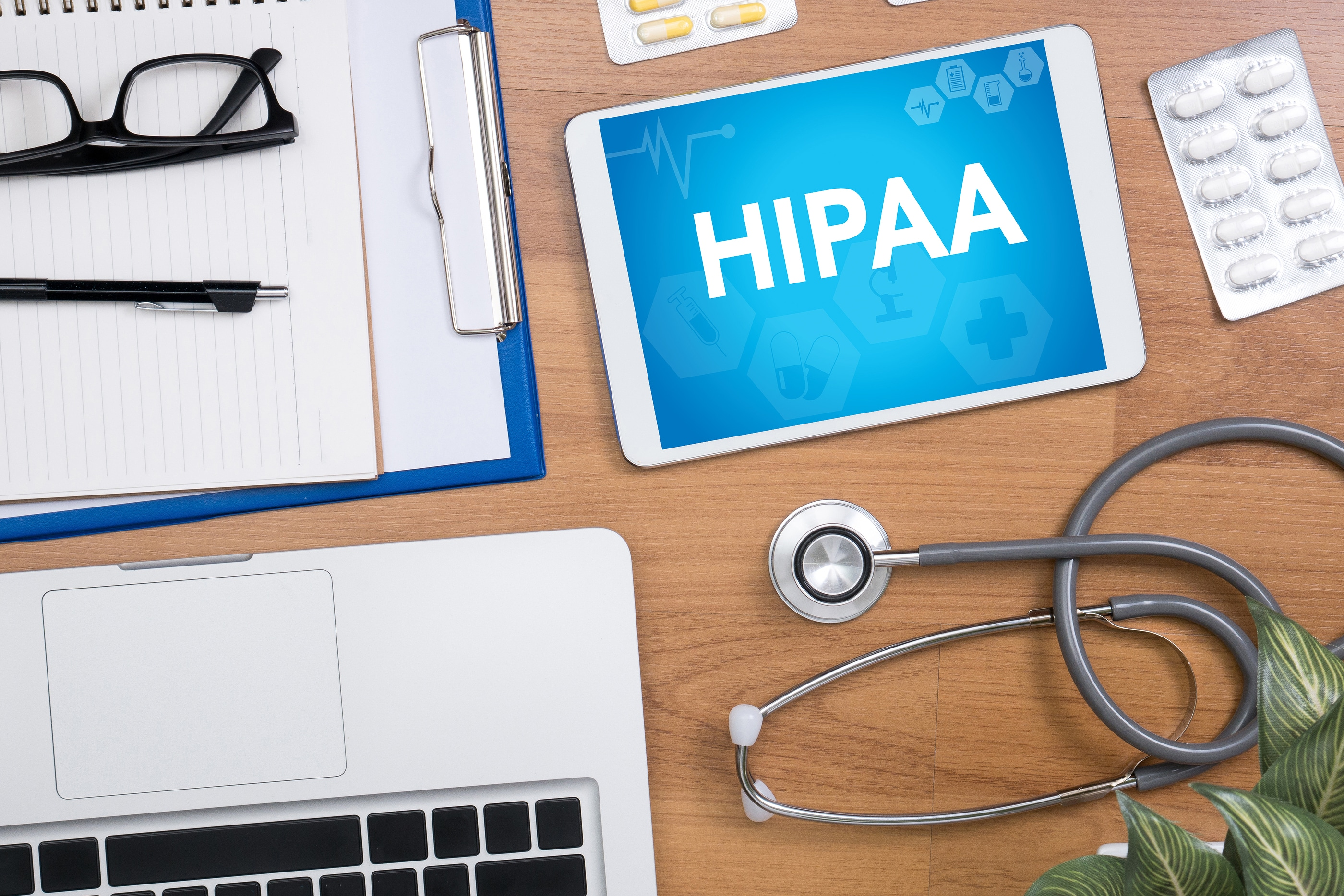 HIPAA Professional doctor use computer and medical equipment all around desktop top view
