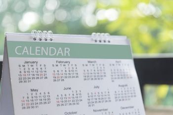 2019 Calendar Event Planner. Close up on calendar on desk with bokeh and sun light as a background with copy space. Schedule using calendar set timetable on organize schedule. Timeline Concept.